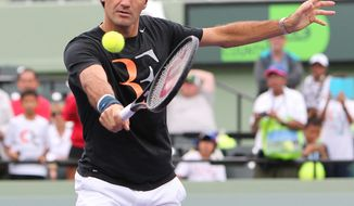 Roger Federer, from Switzerland, returns the ball during practice atthe Sony Open tennis tournament at Crandon Park in Key Biscayne on Tuesday, March 18, 2014. (AP Photo/El Nuevo Herald, David Santiago)  MAGS OUT