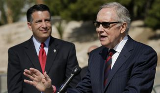 Senate majority leader Harry Reid, right, speaks at a news conference,Thursday, March 20, 2014, in Las Vegas. Reid and Nevada governor Brian Sandoval, left, talked about a new report which shows at least $5.5 billion has been invested in Nevada's clean energy sector since 2010. (AP Photo/Julie Jacobson)