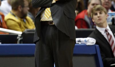 Wofford head coach Mike Young reacts to a play during the first half of a second round NCAA college basketball tournament game against the Michigan Thursday, March 20, 2014, in Milwaukee. (AP Photo/Jeffrey Phelps)