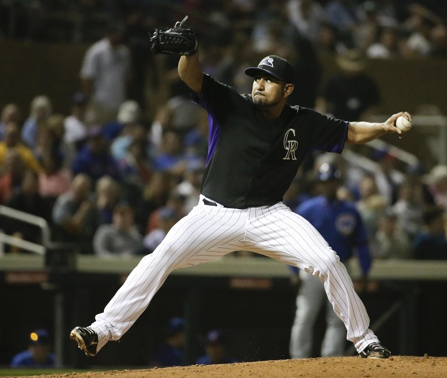 Colorado Rockies starting pitcher Franklin Morales throws to the Chicago Cubs during the second inning of a spring exhibition baseball game in Scottsdale, Ariz., Wednesday, March 19, 2014. (AP Photo/Chris Carlson)