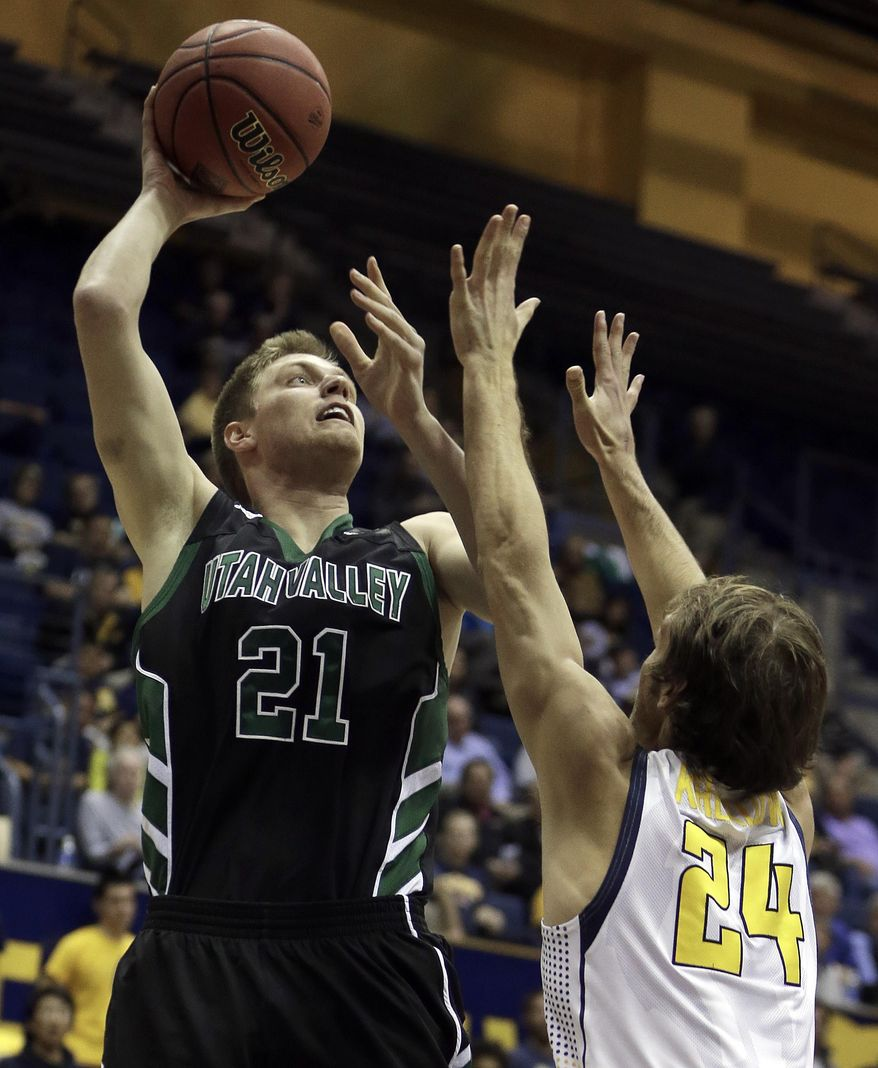 Utah Valley's Zach Nelson (21) shoots over California's Ricky Kreklow, right, in the first half of an NCAA college basketball game Wednesday, March 19, 2014, in Berkeley, Calif. (AP Photo/Ben Margot)