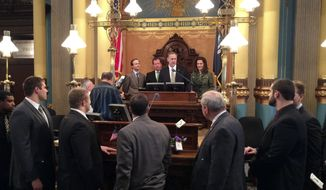 Michigan State head football coach Mark Dantonio speaks following the school's first Rose Bowl victory in over a quarter-century in the Michigan Senate chamber as members of the football team were honored at the Michigan capitol building Thursday, March 20, 2014, in Lansing, Mich. (AP Photo/Emma Fidel)