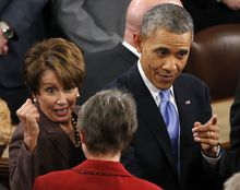 **FILE** President Obama, accompanied by House Minority Leader Nancy Pelosi of Calif., leaves after giving his State of the Union address on Capitol Hill in Washington on Jan. 28, 2014. (Associated Press)