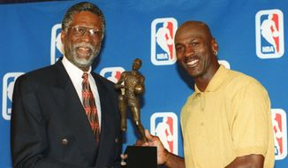 Chicago Bulls' Michael Jordan, right, holds his fifth Most Valuable Player award with Bill Russell of the Boston Celtics at a ceremony in Northbrook, Ill., Monday, May 18, 1998. Jordan perviously won the award in 1998, 1991, 1992, and 1996. Russell, who presented the award, is the only other five-time winner.  (AP Photo/Jay Crihfield)