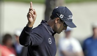 Adam Scott, of Australia, reacts after making an eagle putt on the 16th hole during the first round of the Arnold Palmer Invitational golf tournament at Bay Hill Thursday, March 20, 2014, in Orlando, Fla. (AP Photo/Chris O'Meara)