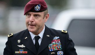 Brig Gen. Jeff Sinclair arrives to the Fort Bragg courthouse, for his sentencing hearing, Wednesday, March 19, 2014, in Fort Bragg, N.C. Sinclair, who was accused of sexually assaulting a subordinate, plead guilty to lesser charges in a plea deal reached with government prosecutors. (AP Photo/The Fayetteville Observer, Andrew Craft) MANDATORY CREDIT