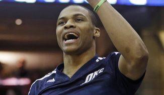 Oklahoma City Thunder's Russell Westbrook cheers on his team during the first quarter of an NBA basketball game against the Cleveland Cavaliers on Thursday, March 20, 2014, in Cleveland. Oklahoma City defeated Cleveland 102-95. (AP Photo/Tony Dejak)