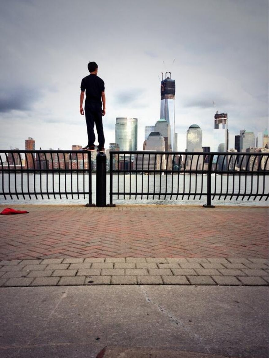 Justin Casquejo, 16, of New Jersey posted to Twitter in August this photo of himself facing 1 World Trade Center in lower Manhattan.