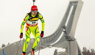 Winner Jakov Fak from Slovenia competes in the men's IBU Biathlon World Cup sprint 10 km in the Holmenkollen Ski Arena in Oslo, Thursday, March 20, 2014. (AP Photo/Erlend Aas/NTB scanpix)   NORWAY OUT