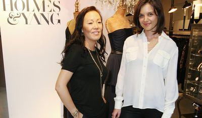 FILE - This Sept. 24, 2009 file photo released by Perrier Jouet Champagne shows actress Katie Holmes, right, and Jeanne Yang at the Holmes & Yang launch party in Los Angeles. (AP Photo/Perrier Jouet Champagne, Casey Rodgers)