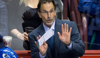 Vancouver Canucks head coach John Tortorella gestures on the bench during third period of an NHL hockey action against the Nashville Predators in Vancouver, British Columbia, on Wednesday, March 19, 2014. (AP Photo/The Canadian Press, Darryl Dyck)