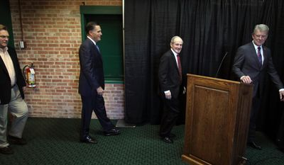 Former Republican presidential candidate Mitt Romney, second from left, holds on news conference to endorse Idaho Gov. Butch Otter, right, Sen. Jim Risch, second from right, and Rep. Mike Simpson, left, after a fundraising lunch at the Powerhouse Event Center on Thursday, March 20, 2014, in Boise, Idaho. (AP Photo/The Idaho Statesman, Joe Jaszewski)  LOCAL TV OUT (KTVB 7)