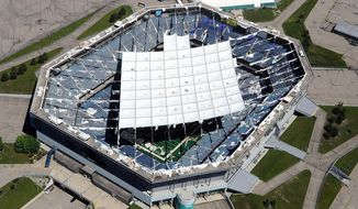 FILE - This June 18, 2013 file photo, shows an aerial view of the shredded roof of the Pontiac Silverdome in Pontiac, Mich. Seats, signs and even urinals from the Detroit Lions' former home will be going up for auction. The Pontiac Silverdome is owned by Triple Investment Group, which says the auction will be held May 12-16, 2014.  (AP Photo/The Oakland Press, Vaughn Gurganian)