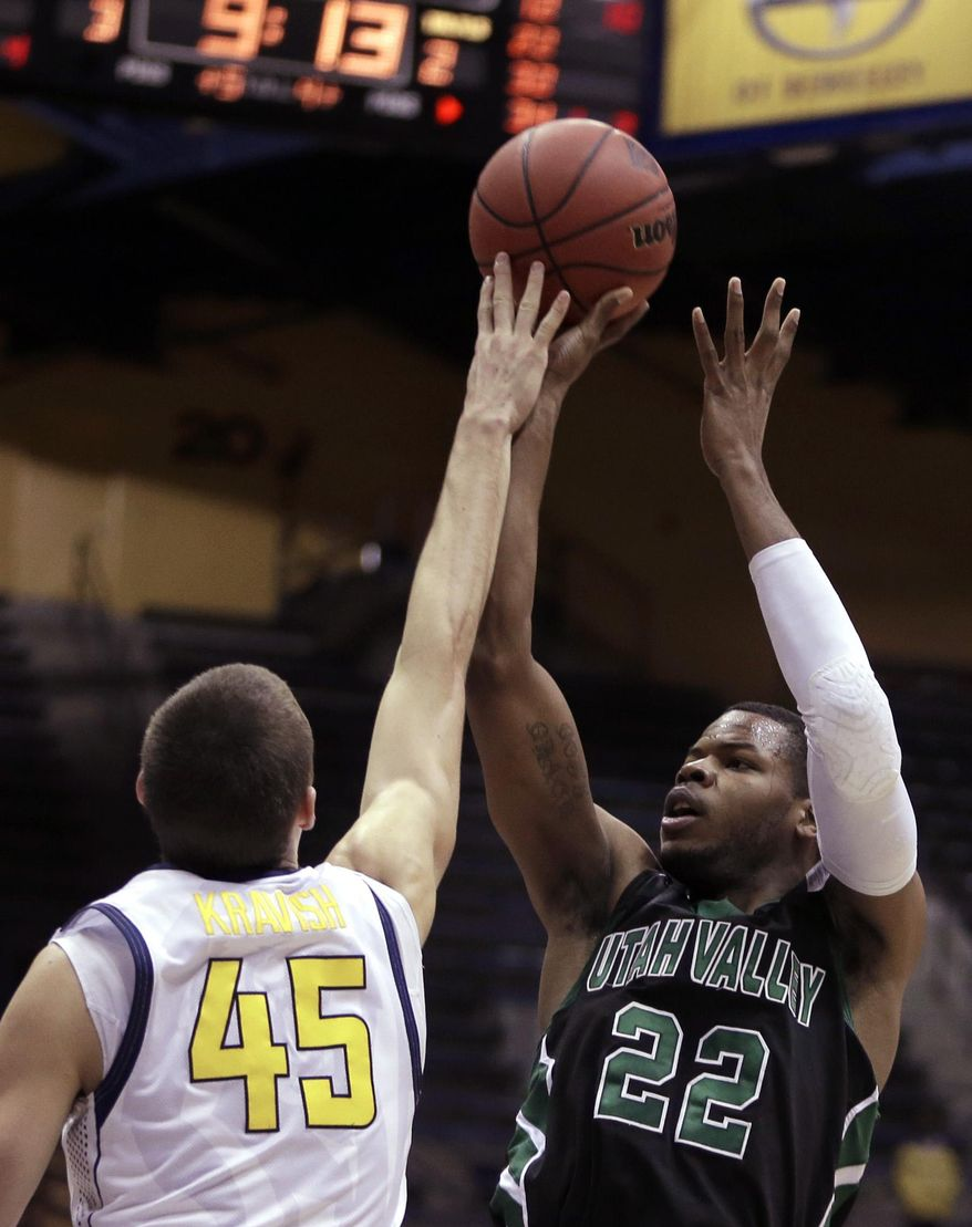 Utah Valley's Chad Ross, right, shoots against California's David Kravish (45) in the first half of an NCAA college basketball game Wednesday, March 19, 2014, in Berkeley, Calif. (AP Photo/Ben Margot)