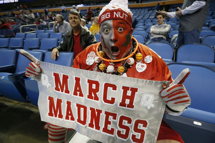 Jon Peters, of Ohio, gets in the spirit of March Madness before a second-round game of the NCAA college basketball tournament between Ohio State and Dayton in Buffalo, N.Y., Thursday, March 20, 2014.  (AP Photo/The Buffalo News, Robert Kirkham) TV OUT; MAGS OUT; MANDATORY CREDIT; BATAVIA DAILY NEWS OUT; DUNKIRK OBSERVER OUT; JAMESTOWN POST-JOURNAL OUT; LOCKPORT UNION-SUN JOURNAL OUT; NIAGARA GAZETTE OUT; OLEAN TIMES-HERALD OUT; SALAMANCA PRESS OUT; TONAWANDA NEWS OUT