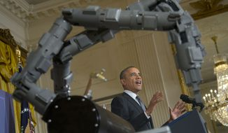 ** FILE ** In this Feb. 25, 2014, file photo, President Barack Obama, standing next to a robotic arm, speaks about manufacturing innovation institutes, in the East Room of the White House in Washington. (AP Photo/Pablo Martinez Monsivais, File)