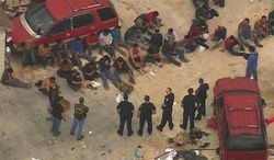 More than 100 suspected illegal immigrants were found being held hostage in a filthy Houston stash house on Wednesday. (AIR 11)