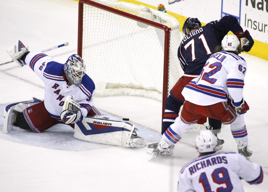 Columbus Blue Jackets' Nick Foligno (71) shoots off the post past New York Rangers goalie Henrik Lundqvist (30) during the third period of an NHL hockey game, Friday, March 21, 2014, in Columbus, Ohio. (AP Photo/Mike Munden)