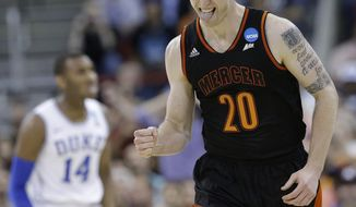 Mercer forward Jakob Gollon (20) celebrates a basket against Duke during the first half of a second-round game in the NCAA college basketball tournament, Friday, March 21, 2014, in Raleigh, N.C. (AP Photo/Gerry Broome)