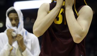 Arizona State forward Jonathan Gilling, right, walks off the court after Texas defeated Arizona State 87-85 in a second-round game of the NCAA college basketball tournament Thursday, March 20, 2014, in Milwaukee. (AP Photo/Morry Gash)