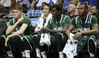 Cal Poly players watch from the bench against Wichita State during the second half of a second-round game in the NCAA college basketball tournament Friday, March 21, 2014, in St. Louis. (AP Photo/Charlie Riedel)