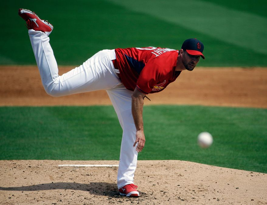 St. Louis Cardinals starting pitcher Adam Wainwright throws in the second inning of an exhibition spring training baseball game against the Washington Nationals, Friday, March 21, 2014, in Jupiter, Fla. (AP Photo/David Goldman)
