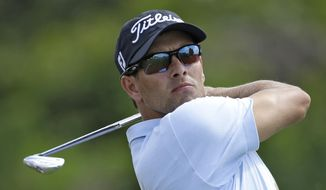 Adam Scott, of Australia, tees off on the seventh hole during the second round of the Arnold Palmer Invitational golf tournament at Bay Hill Friday, March 21, 2014, in Orlando, Fla. (AP Photo/Chris O'Meara)