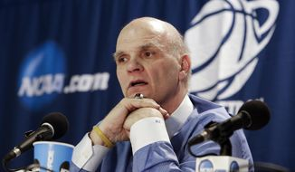 Saint Joseph's head coach Phil Martelli answers questions to during a news conference after a second-round game against Connecticut in the NCAA college basketball tournament in Buffalo, N.Y., Thursday, March 20, 2014. Connecticut won 89-81. (AP Photo/Nick LoVerde)