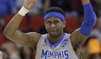 Memphis forward David Pellom (12) reacts to play against George Washington during the first half of an NCAA college basketball second-round tournament game, Friday, March 21, 2014, in Raleigh. (AP Photo/Gerry Broome)