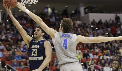 George Washington guard/forward Patricio Garino (13) shoots against Memphis forward Austin Nichols (4) during the first half of an NCAA college basketball second-round tournament game, Friday, March 21, 2014, in Raleigh. (AP Photo/Gerry Broome)
