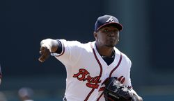Atlanta Braves starting pitcher Julio Teheran throws during the first inning of a spring exhibition baseball game against the Detroit Tigers in Kissimmee, Fla., Friday, March 21, 2014. (AP Photo/Carlos Osorio)