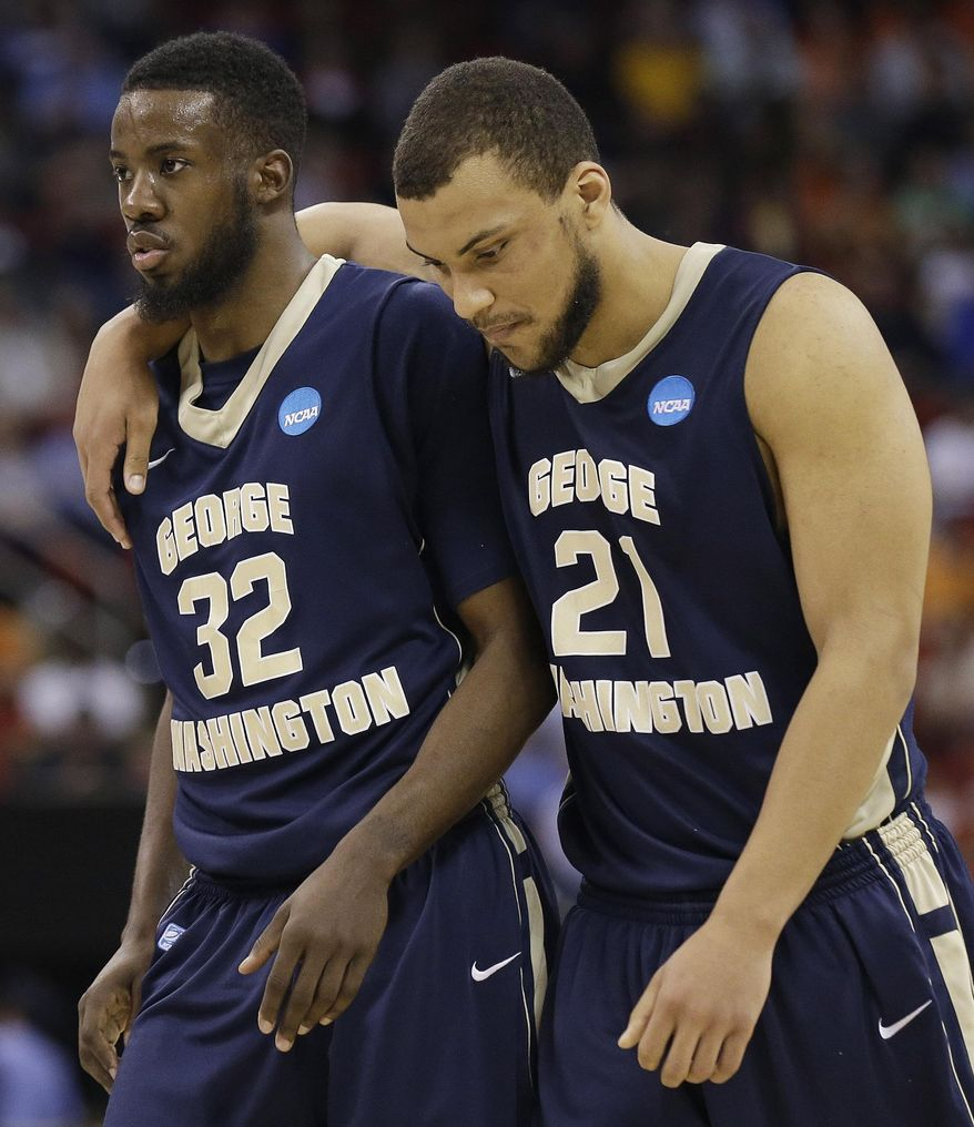 George Washington's Isaiah Armwood (32) and Kevin Larsen (21) walk off the court after the second half of an NCAA college basketball second-round tournament game against Memphis, Friday, March 21, 2014, in Raleigh. Memphis won 71-66. (AP Photo/Gerry Broome)