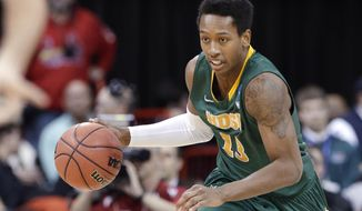 North Dakota State's Carlin Dupree races up court against Oklahoma in overtime during a second-round game of the NCAA men's college basketball tournament in Spokane, Wash., Thursday, March 20, 2014. North Dakota State won 80-75 in overtime. (AP Photo/Elaine Thompson)