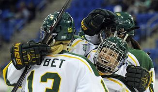 Clarkson's players celebrate after their third goal against Mercyhurst during the second period in an NCAA college hockey game in the semifinals of the women's Frozen Four in Hamden, Conn., Friday, March 21, 2014. (AP Photo/Fred Beckham)