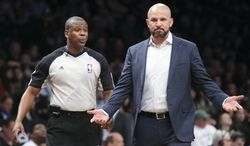 Brooklyn Nets head coach Jason Kidd reacts during the first half of an NBA basketball game against the Boston Celtics at the Barclays Center, Friday, March 21, 2014, in New York. (AP Photo/John Minchillo)