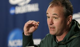 North Dakota State head coach Saul Phillips speaks at a news conference before the third round of the NCAA men's college basketball tournament in Spokane, Wash., Friday, March 21, 2014. North Dakota State plays San Diego State on Saturday. (AP Photo/Elaine Thompson)