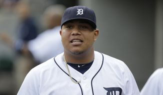 FILE - In this Aug. 26. 2013, file photo, Detroit Tigers pitcher Bruce Rondon watches from the dugout during the second inning of a baseball game against the Oakland Athletics in Detroit. Rondon needs surgery to repair a torn ligament in his right elbow and will be sidelined for the entire season, general manager Dave Dombrowski said Friday, March 21, 2014. (AP Photo/Paul Sancya, File)
