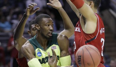 Baylor's Cory Jefferson, left, is pressured by Nebraska's Walter Pitchford, right, during the first half of a second-round game in the NCAA college basketball tournament Friday, March 21, 2014, in San Antonio. (AP Photo/Eric Gay)