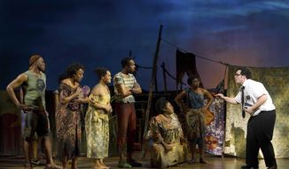 """FILE - In this file image released by Boneau/Bryan-Brown, Josh Gad, right, performs with an ensemble cast in """"The Book of Mormon"""" at the Eugene O'Neill Theatre in New York. The ticket-selling website StubHub said Friday, March 21, 2014, it will provide direct access to premium tickets to the Tony Award-winning smash, marking the first time the site will directly distribute tickets for a Broadway show. (AP Photo/Boneau/Bryan-Brown, Joan Marcus)"""