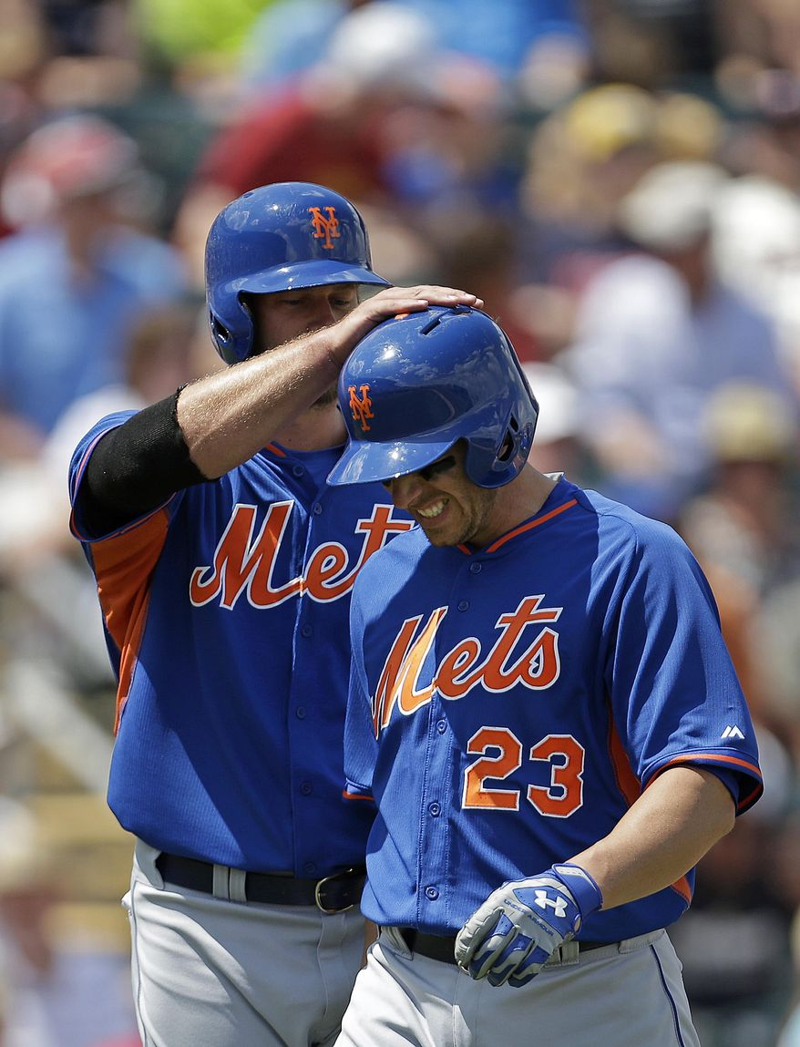 New York Mets' Taylor Teagarden (23) is congratulated at the plate by Kirk Nieuwenhuis after his two-run homer in the first inning of a exhibition baseball game against the Minnesota Twins in Fort Myers, Fla., Friday, March 21, 2014. (AP Photo/Gerald Herbert)