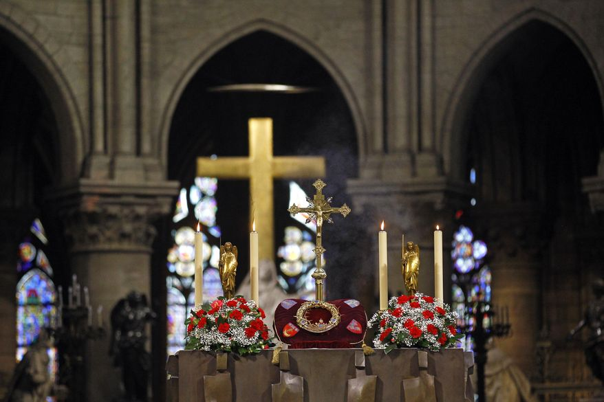 A crown of thorns that was believed to have been worn by Jesus Christ, and which was bought by King Louis IX in 1239, is presented at Notre Dame Cathedral in Paris, Friday, March 21, 2014. To mark the 800th anniversary of Louis IX's christening, the crown of thorns will be displayed outside Notre Dame, at the Collegiate Church of Poissy, where King Louis IX was christened.  (AP Photo/Remy de la Mauviniere)