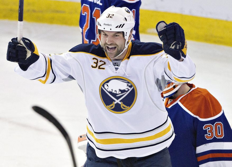 Buffalo Sabres' John Scott (32) celebrate a goal against the Edmonton Oilers during the second period of an NHL hockey game in Edmonton, Alberta, on Thursday, March 20, 2014. (AP Photo/The Canadian Press, Jason Franson)