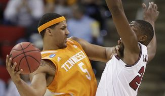 Tennessee forward Jarnell Stokes (5) shoots against Massachusetts' Cady Lalanne during the first half of an NCAA college basketball second-round tournament game, Friday, March 21, 2014, in Raleigh, N.C. (AP Photo/Chuck Burton)
