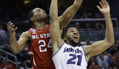North Carolina State forward T.J. Warren (24) drives to the basket over Saint Louis forward Dwayne Evans (21) during the second half in a second-round game in the NCAA college basketball tournament Thursday, March 20, 2014, in Orlando, Fla. (AP Photo/John Raoux)