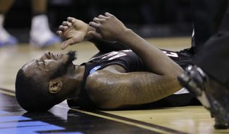 Louisiana-Lafayette's Bryant Mbamalu shows his frustration after he was called for a foul against Creighton during the second half of a second-round game in the NCAA college basketball tournament Friday, March 21, 2014, in San Antonio. Creighton won 76-66.  (AP Photo/Eric Gay)