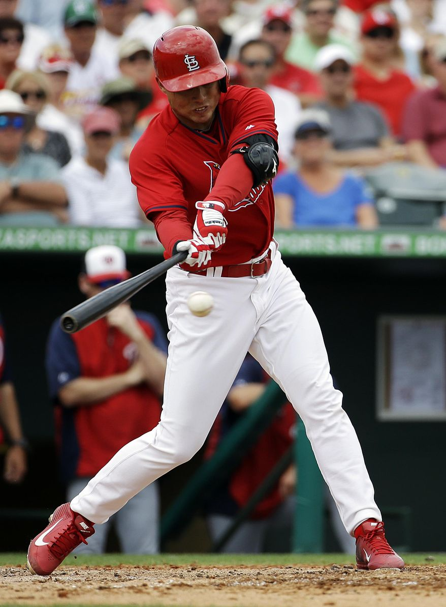 St. Louis Cardinals' Aledmys Diaz hits a single in the fourth inning of an exhibition spring training baseball game against the Washington Nationals, Friday, March 21, 2014, in Jupiter, Fla. (AP Photo/David Goldman)