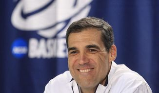 Villanova coach Jay Wright speaks during a media session during the the men's NCAA college basketball tournament at First Niagara Center in Buffalo, N.Y., Friday, March 21, 2014.  (AP Photo/The Buffalo News, Harry Scull Jr.)