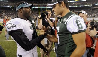 Philadelphia Eagles' Michael Vick, left, greets New York Jets' Mark Sanchez after an NFL preseason football game Thursday, Sept. 1, 2011, in East Rutherford, N.J. The Eagles beat the Jets 24-14. (AP Photo/Bill Kostroun)