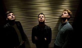 Foster the People band members Jacob Fink, left, Mark Foster, and Mark Pontius, right, pose for a photograph in Toronto on Thursday, March 20, 2014. (AP Photo/The Canadian Press, Nathan Denette)
