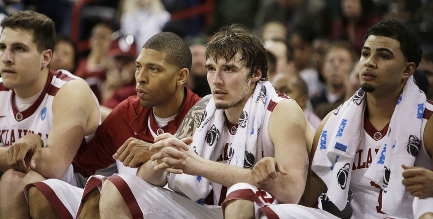 Oklahoma players on the bench watch in overtime during a second-round game of the NCAA men's college basketball tournament against North Dakota State in Spokane, Wash., Thursday, March 20, 2014. North Dakota State won 80-75 in overtime. (AP Photo/Young Kwak)